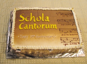 cake iced with: Scola Cantorum Happy 25th Anniversary - and some lines of music for Veni Creator